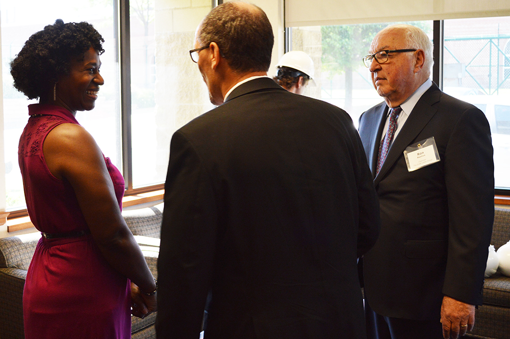 Left to Right: Thomas Perez, U.S. Secretary of Labor; Teonnie Mitchell, Payroll Supervisor, The Great Lakes Towing Company. Mitchell participated in The Great Lakes Towing Company's College Education program.